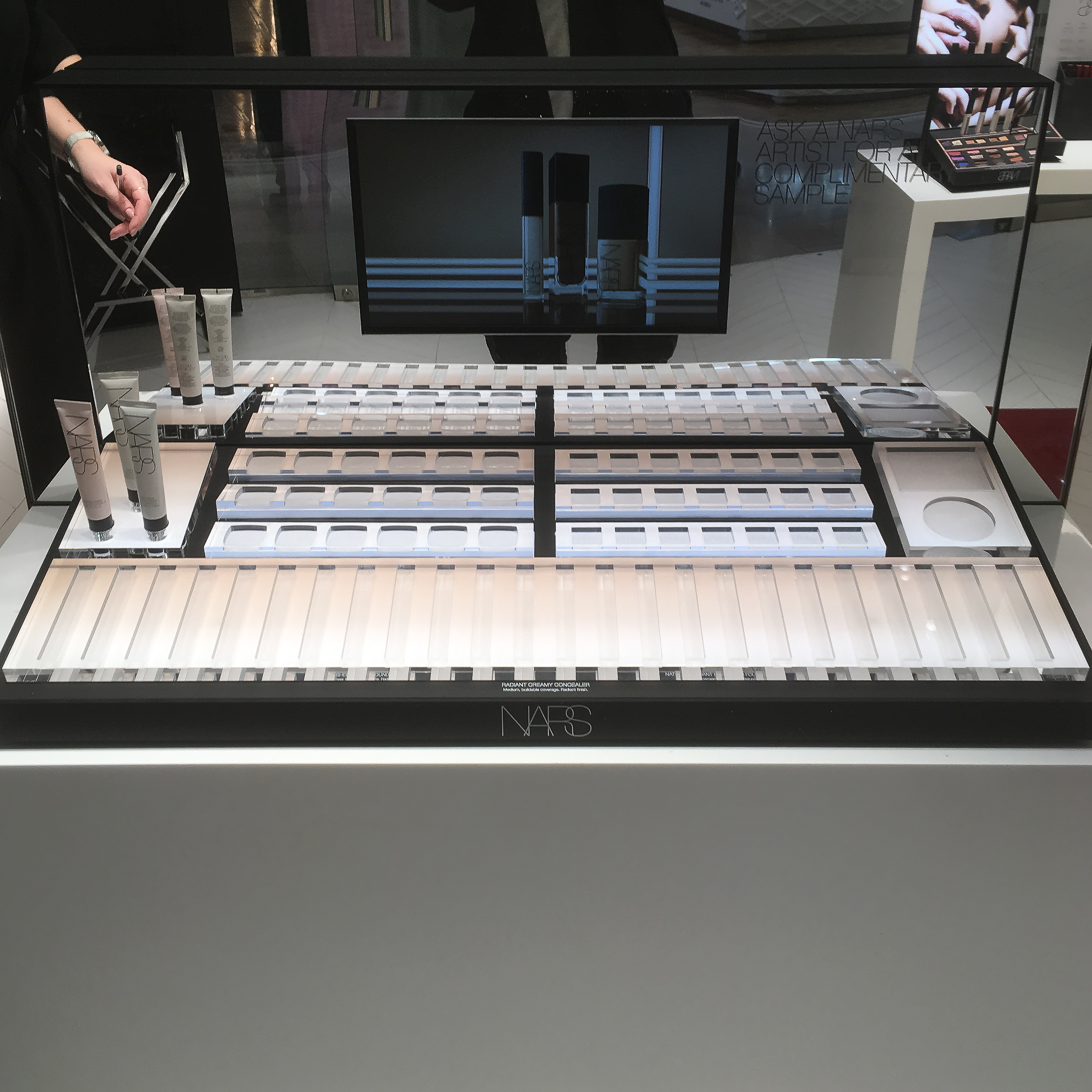 NARS plastic fabricated makeup stand for retail