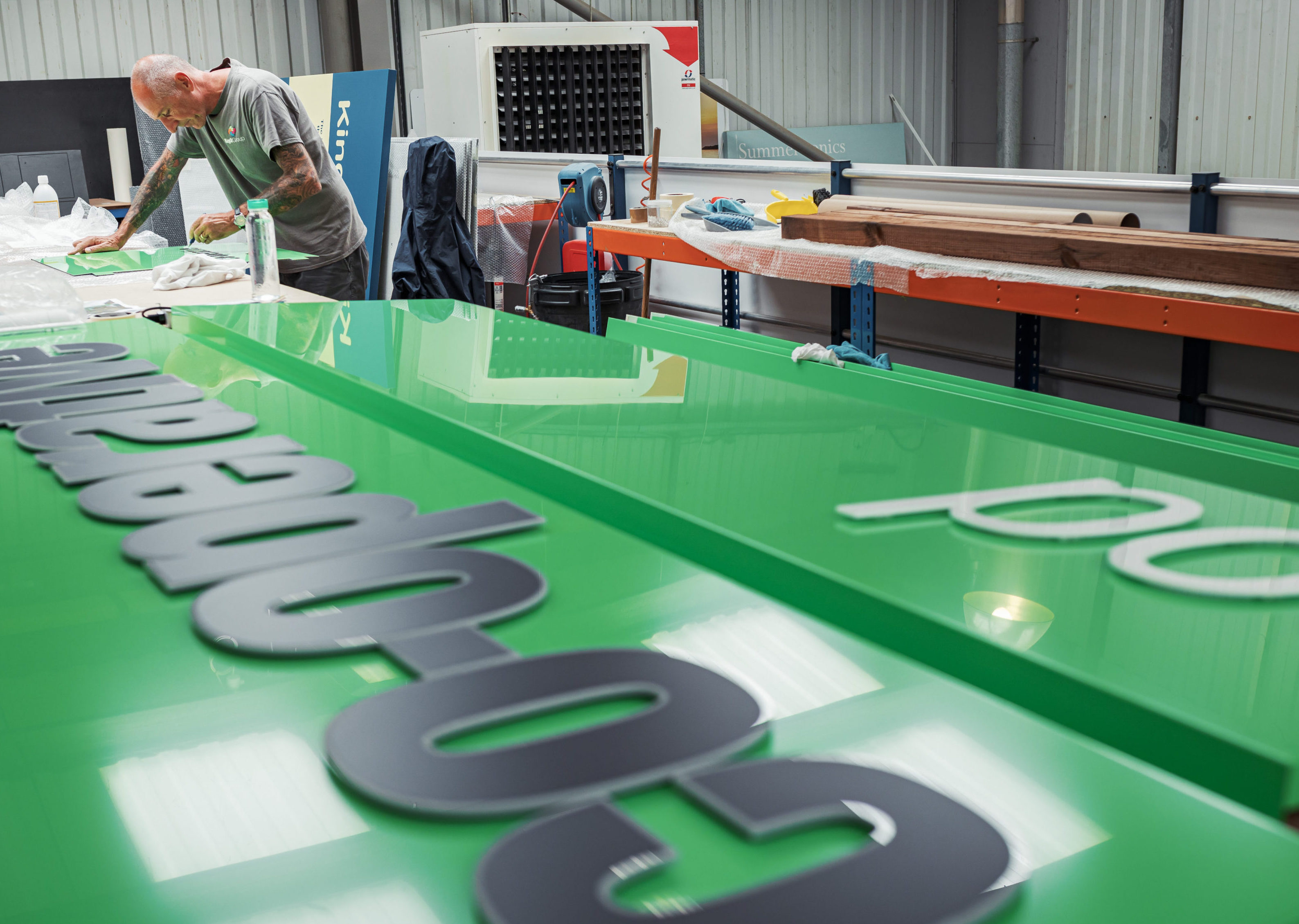 Co-operative signage being made