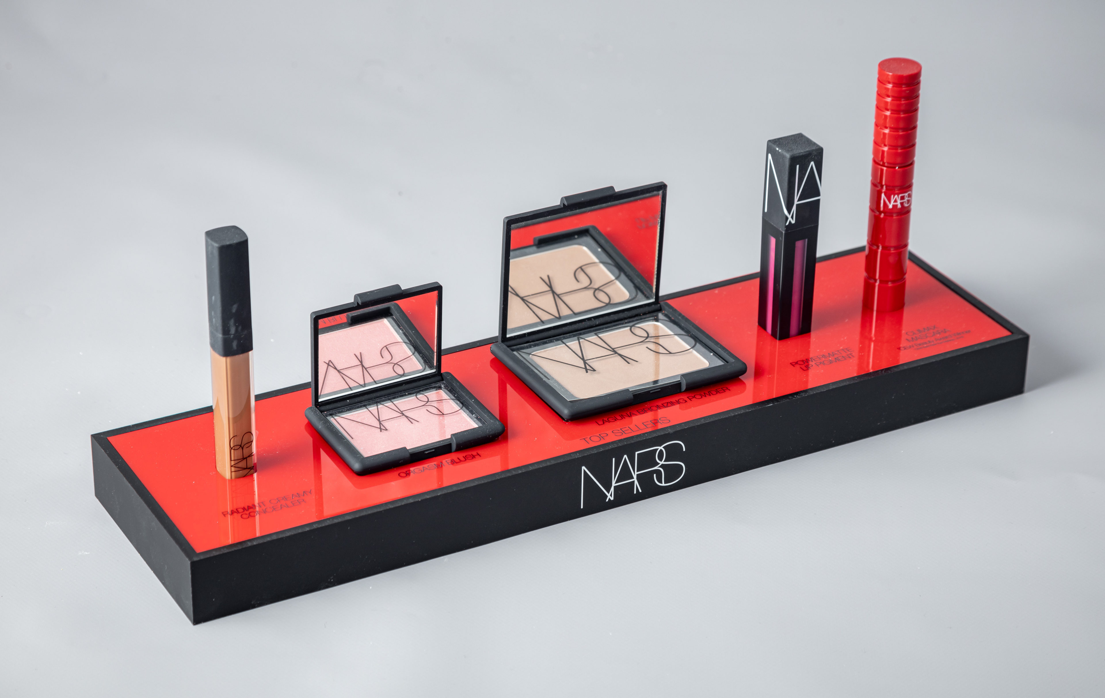 NARS makeup display stand