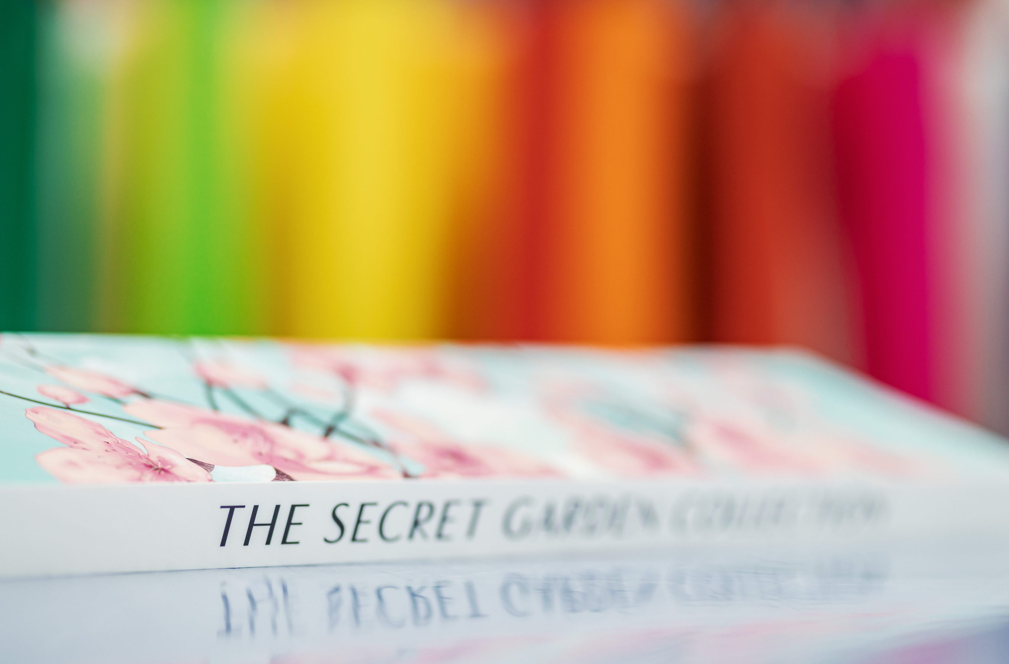 The secret garden book with colours in the background